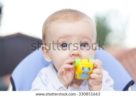 Baby playing with a toy at home