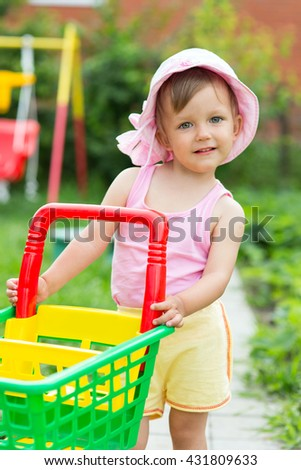 Baby playing with a truck in garden