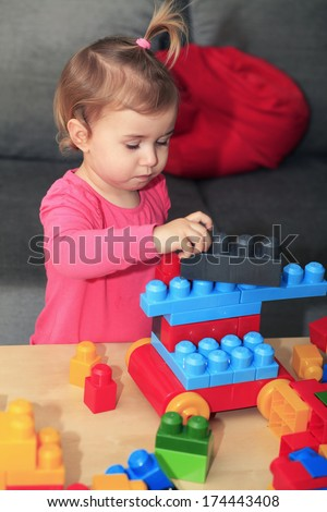 Baby playing with blocks - stock photo