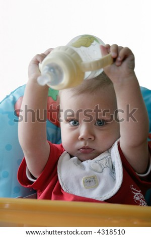 baby playing with bottle