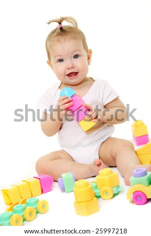 Baby playing with colored blocks