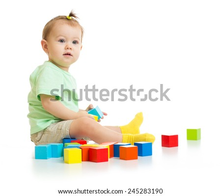 baby playing with colorful blocks isolated - stock photo