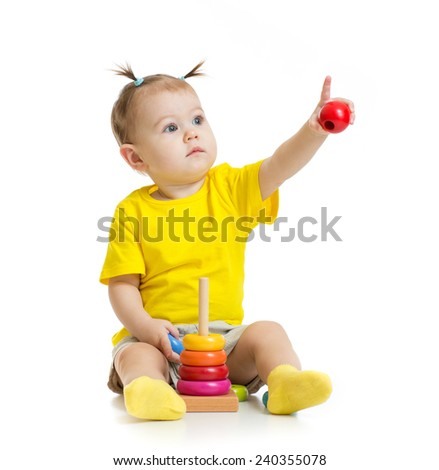 baby playing with colorful toy and pointing by finger isolated - stock photo