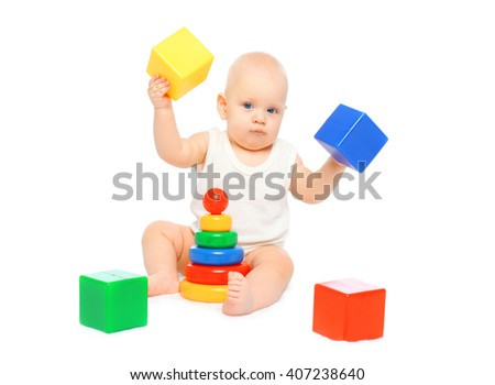 Baby playing with colorful toys on white background - stock photo