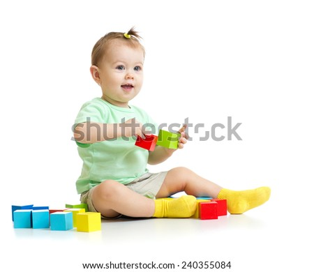 baby playing with colorful wood building blocks isolated - stock photo