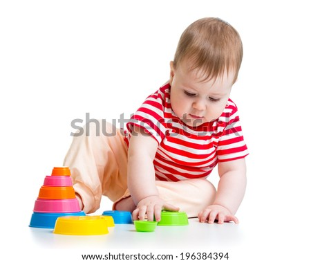 baby playing with cup toys
