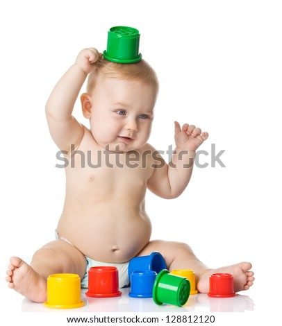 Baby playing with cup toys. Isolated on white background - stock photo