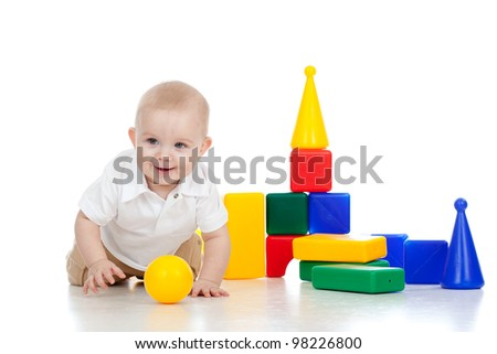 Baby playing with educational cup toys. Isolated on white background - stock photo
