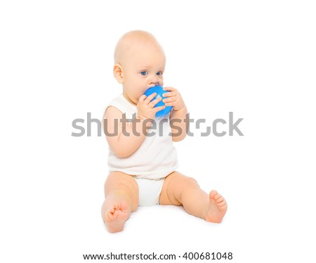 Baby playing with rubber ball on a white background