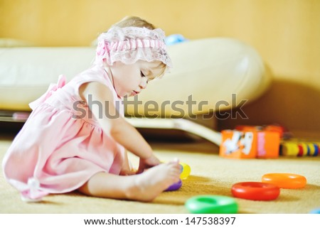 baby playing with toys at home