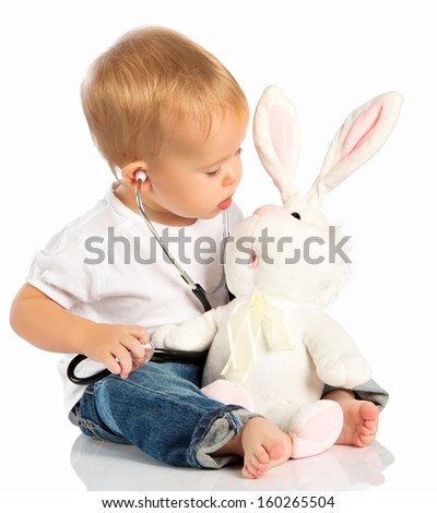 baby plays in doctor toy bunny rabbit and stethoscope - stock photo