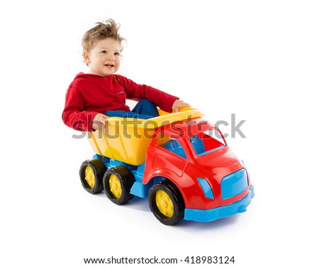 baby plays with truck - stock photo