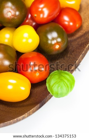 Baby plum tomatoes. Different sorts of tomatoes on white backgrund. Shallow depth of field