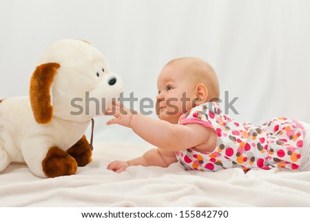 baby portrait with her dog toy - stock photo