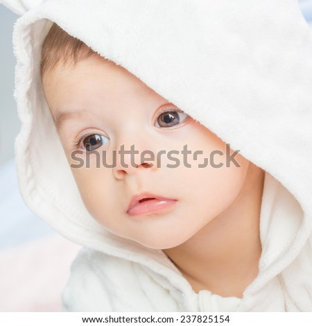 baby portrait with towel after bath. Charming baby. Beautiful baby under  blanket - stock photo