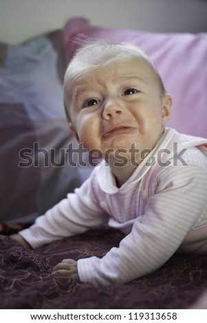 Baby pouting - stock photo