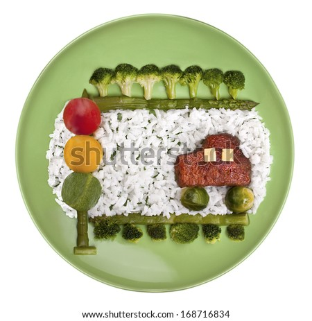 """Baby rice dish with homemade meat cutlet and vegetables """"Great road"""" - stock photo"""
