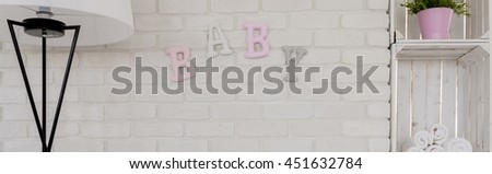 Baby room with with white decorative brick wall  - stock photo