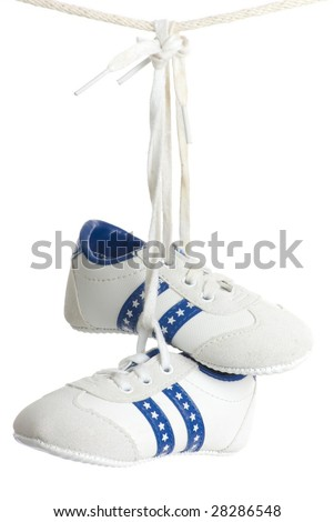 Baby runners hang from line. - stock photo
