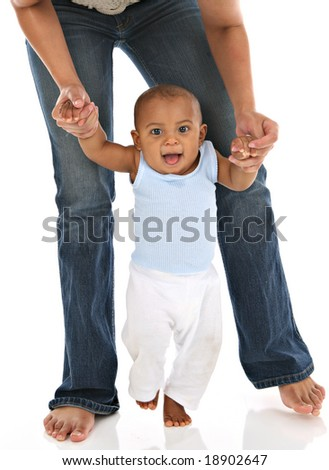 Baby's First Step Holding Mommy Hands - stock photo