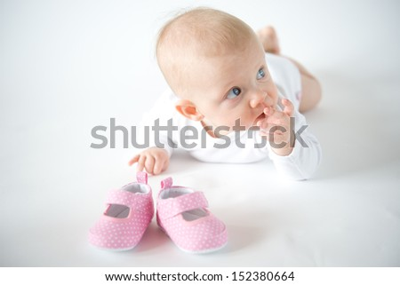 Baby's girl first shoes - stock photo
