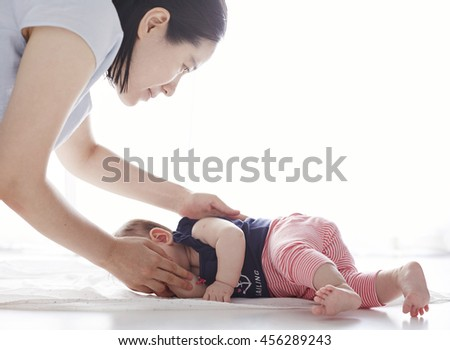 Baby's turn over exercise, in the mother's help
