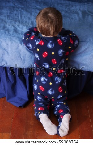 Baby saying his bedtime prayer - stock photo