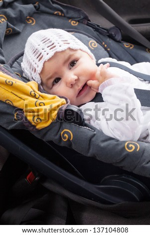 baby seat in the car, model from 0 to 12  month - stock photo