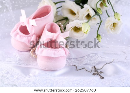Baby shoe, flowers and cross for Christening - stock photo