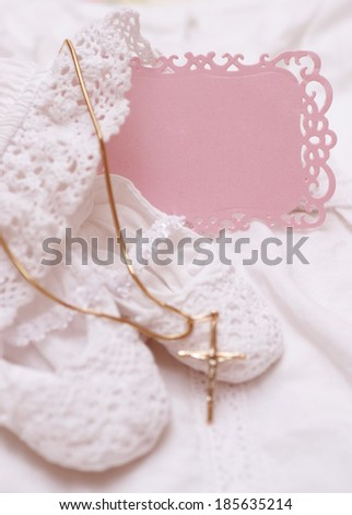 Baby shoes and white dress with golden cross for Christening - stock photo