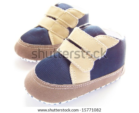baby shoes on white - stock photo