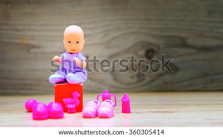 Baby shower decoration. Detail of little doll girl with decoration. It could be used for baby shower card or invitation.  - stock photo