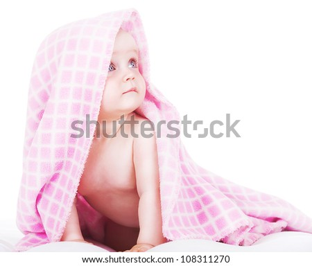 baby siting under towel