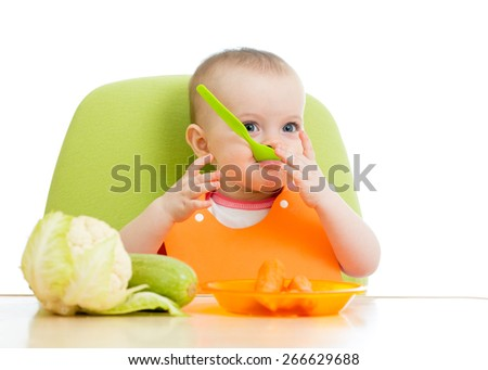 baby sitting at table with  healthy food isolated