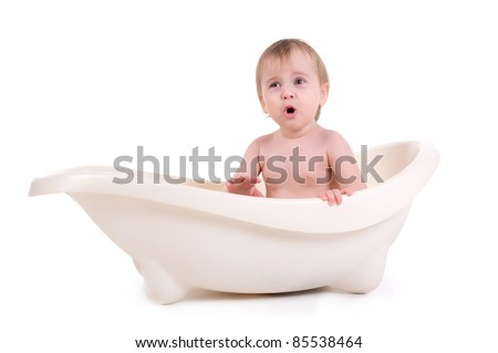 baby sitting in a bath. isolated on white background - stock photo