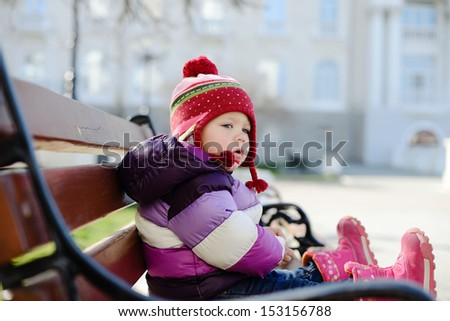 baby  sitting on the bench - stock photo