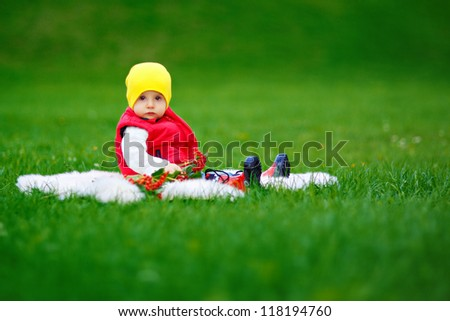 baby sitting on the grass - stock photo