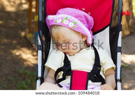 Baby sleep in stroller 3861 - stock photo