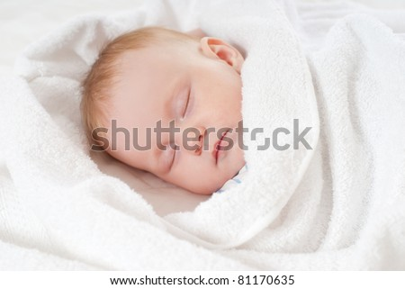 baby sleep under a white blanket
