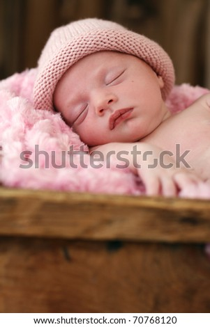 Baby sleeping in a box - stock photo