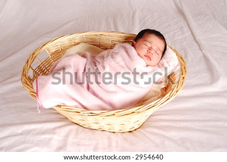 baby sleeping in basket - stock photo