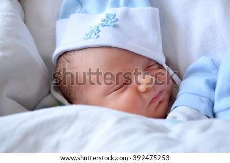 Baby Sleeping in Bed, Newborn Kid Sleep in Hat. Maternity hospital