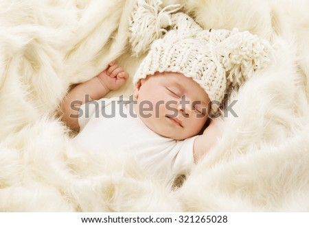 Baby Sleeping in Bed, Newborn Kid Sleep in Hat, New Born One Month Girl - stock photo