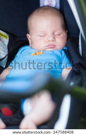 Baby sleeping in car seat. Safty driving concept  - stock photo