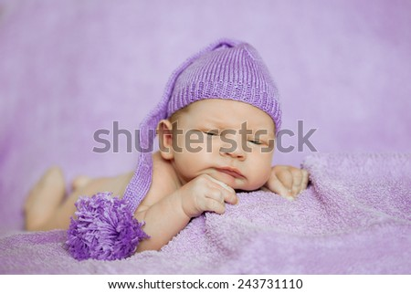 Baby sleeping. Newborn, kid art. Beauty child, boy or girl sleeps in a funny hat - stock photo