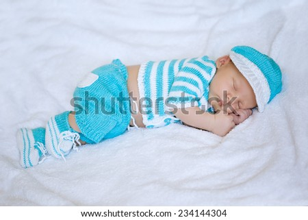 Baby sleeping. Newborn, kid art. Beauty child sleep in shoes and nice clothing - stock photo