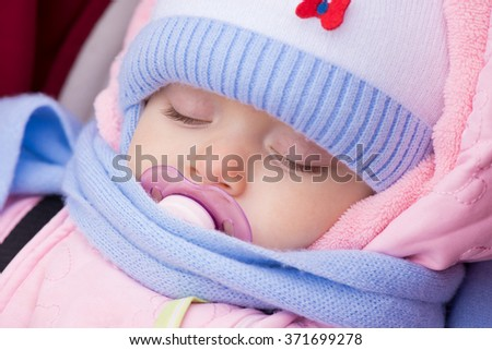 Baby sleeping outdoor - stock photo