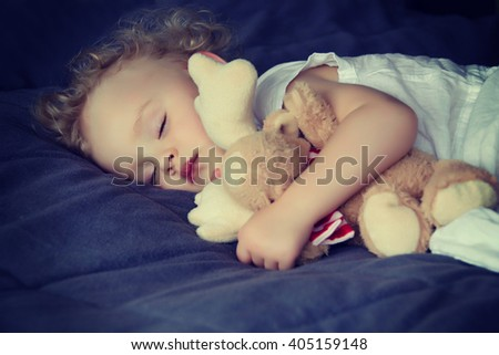 Baby sleeping with toy - stock photo