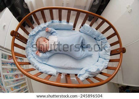 baby sleeps with a cradle