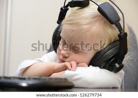 baby sleeps with headphones - stock photo